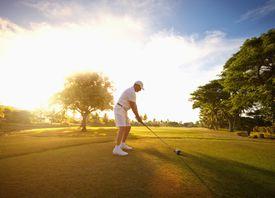 A single golfer teeing off