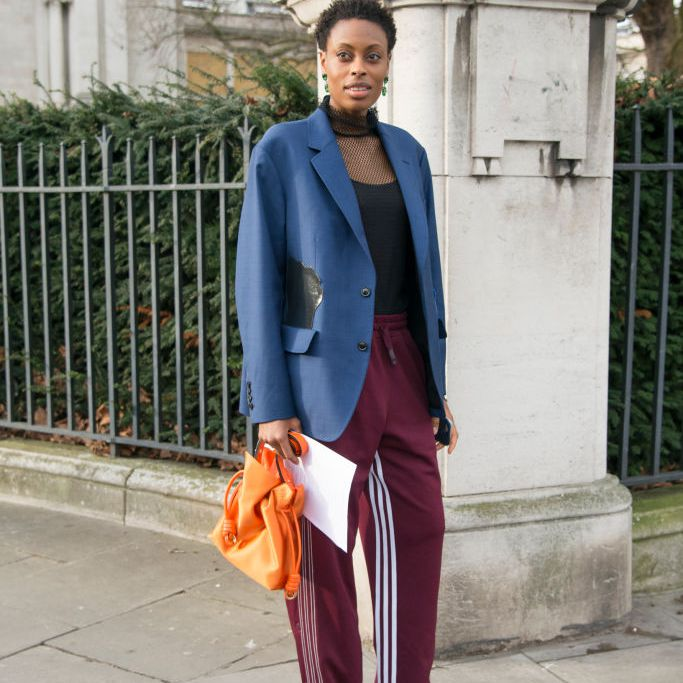 Woman in track pants and blazer