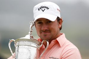Graeme McDowell of Northern Ireland celebrates with the trophy on the 18th green after winning the 110th U.S. Open at Pebble Beach Golf Links on June 20, 2010