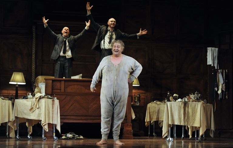 Alasdair Elliott as Bardolph, Ambrogio Maestri as Sir John Falstaff and Lukas Jakobski as Pistol in the Royal Opera's production of Giuseppe Verdi's Falstaff directed by Robert Carsen and conducted by Michael Schonwandt at the Royal Opera House Covent Garden in London.