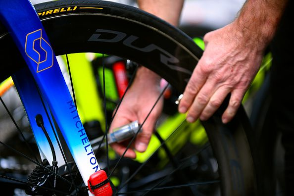 a hand about to inflate a bike tire