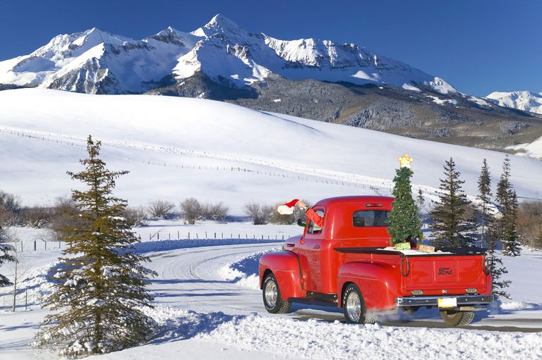 Composite Classic Ford Pick-Up Truck Driven By Person In Santa Apparal & Driving On A Rural Road Beneath Wilson Peak In The San Juan Mountains, Colorado Composite
