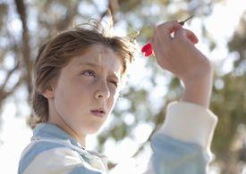 Boy taking aim with dart