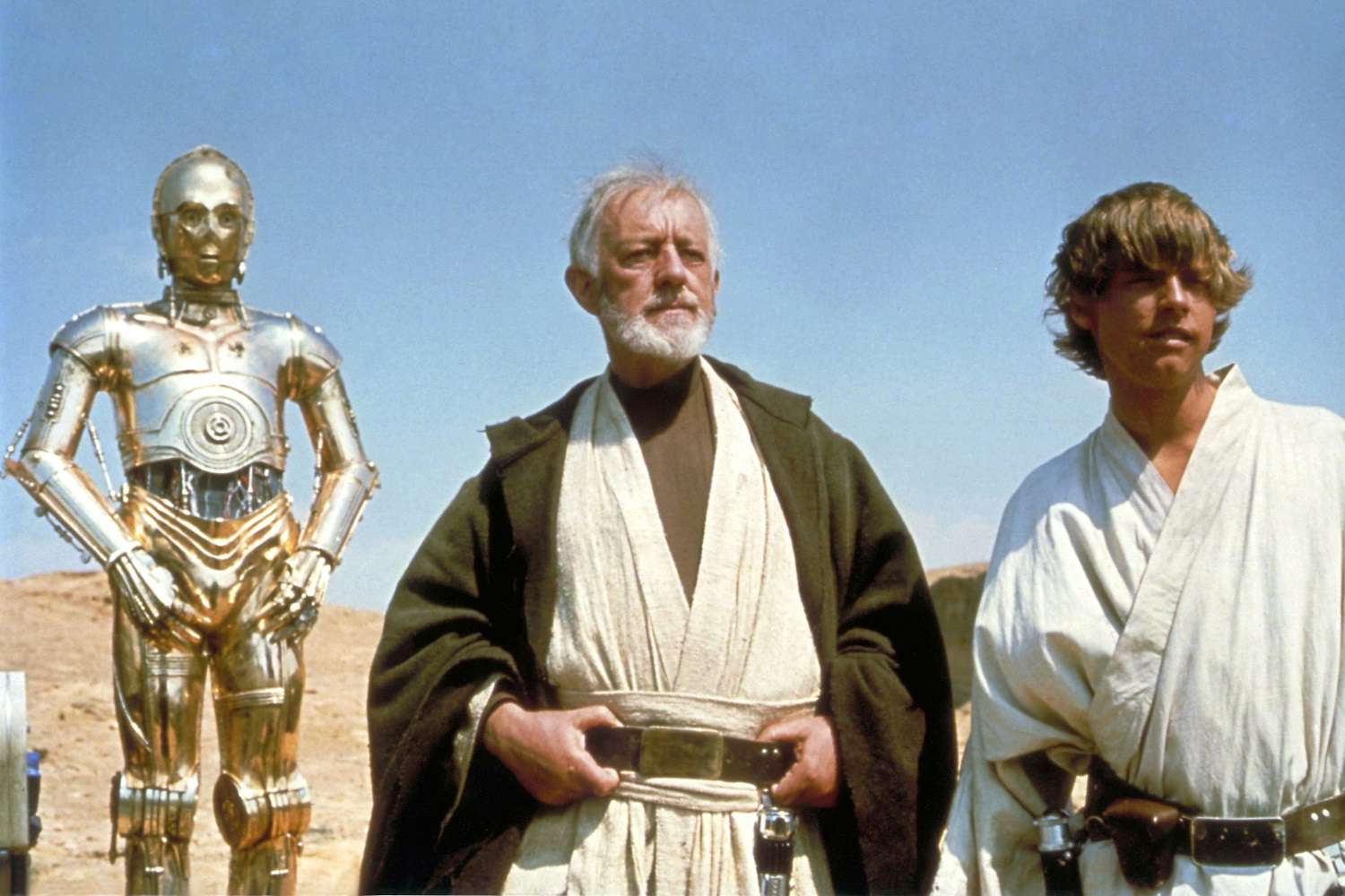 Actors Anthony Daniels, Alec Guinness, and Mark Hamill on the set of the 1977 film 'Star Wars'