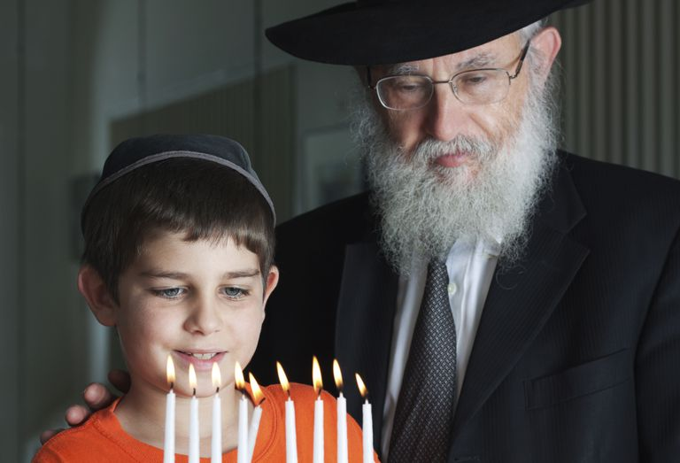 Lighting the Menorah a Jewish grandfather may be called zayde