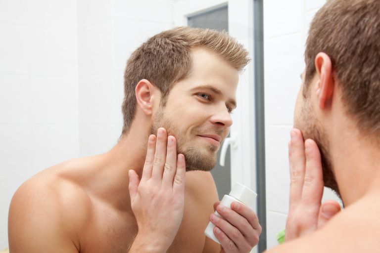 man applying shave oil