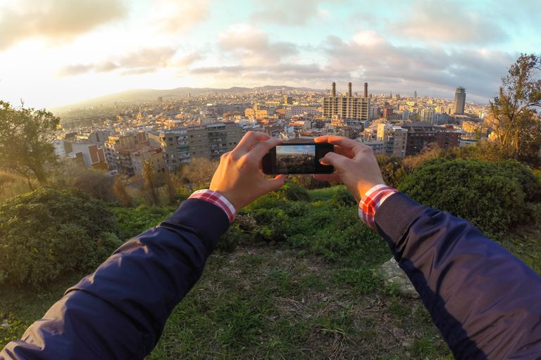 Guy taking city pictures with phone