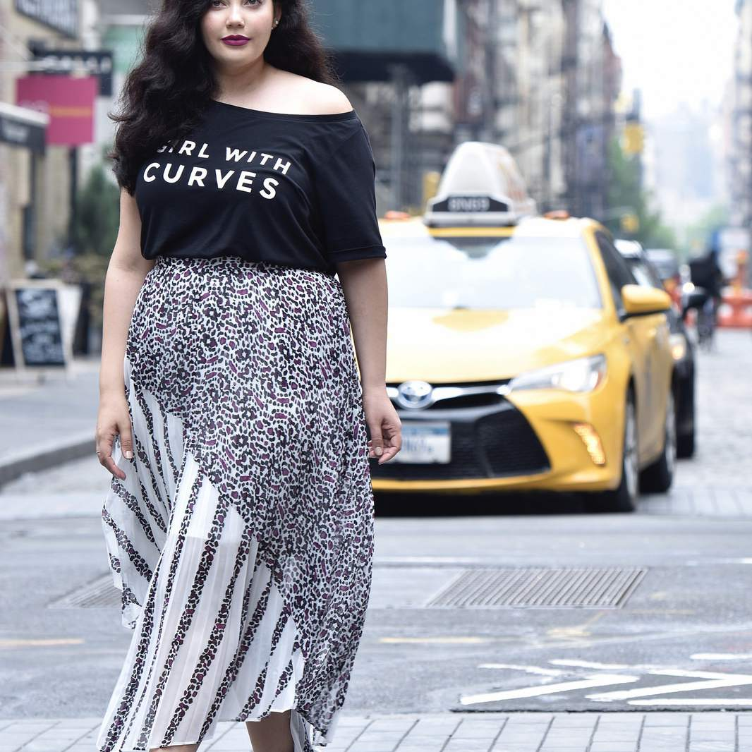 Plus size woman in t-shirt and maxi skirt