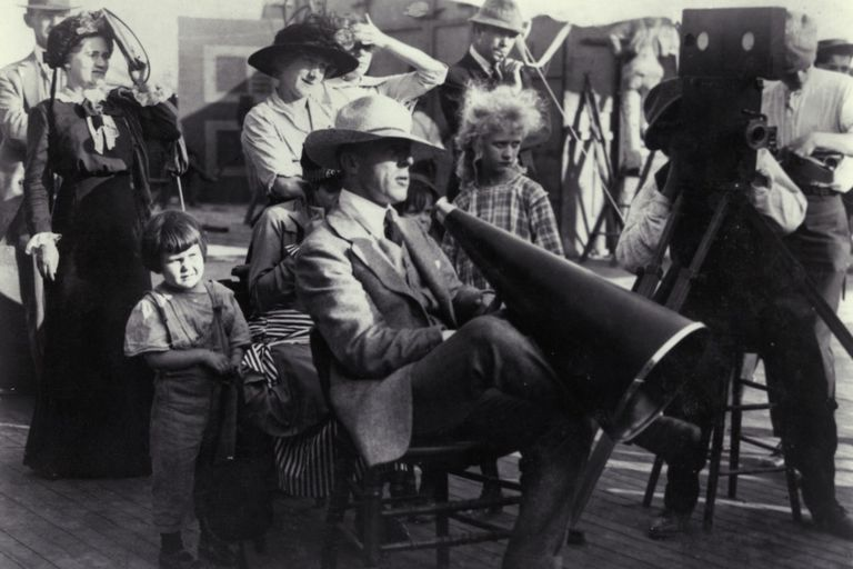 Filmmaker D.W. Griffith directing a film circa 1918