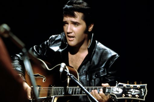 Elvis singing with guitar
