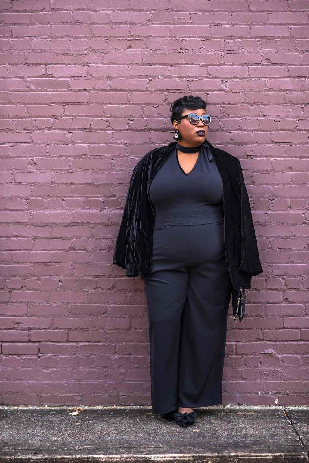 Woman in Black Jumpsuit and Velvet Jacket