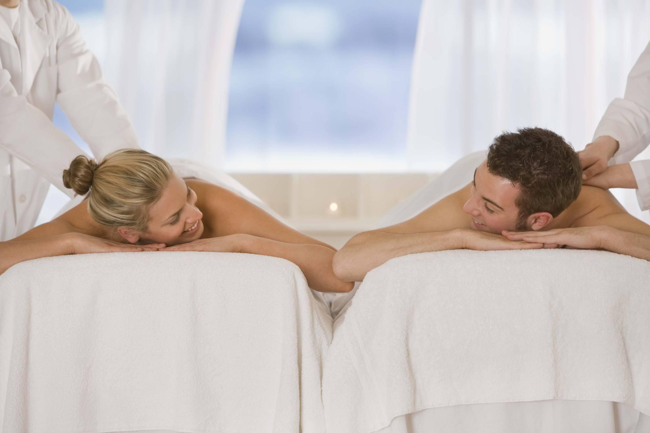 Image of a couple enjoying a massage together.