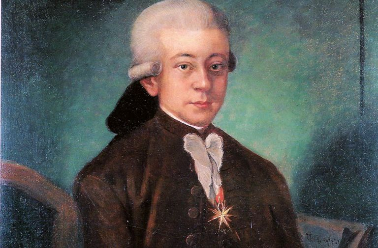 Painted portrait of Mozart sitting at his piano.