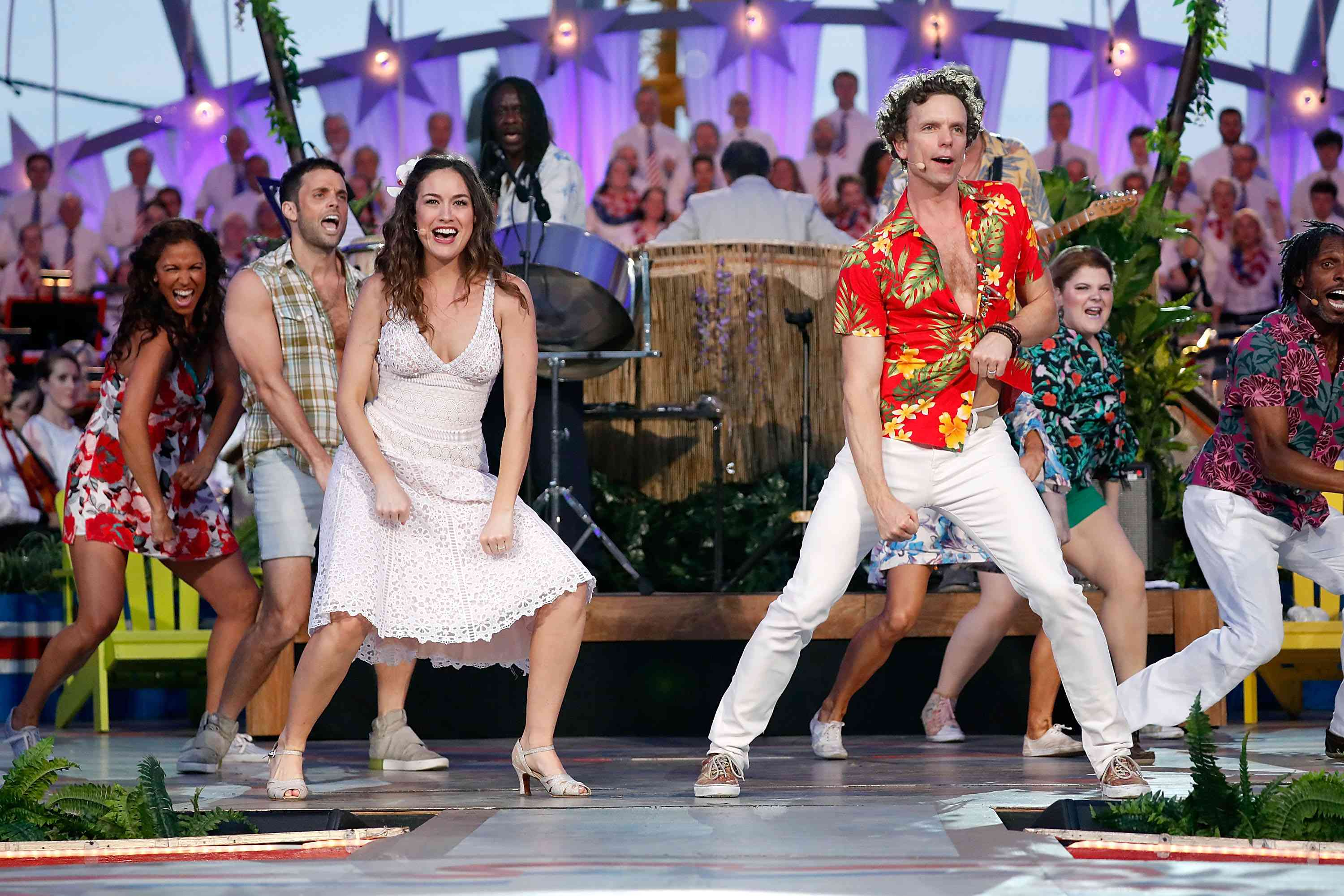 The cast of Margaritaville dancing on stage