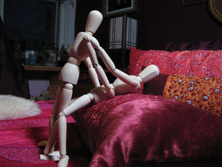 Image of the edge of the bed sex position.