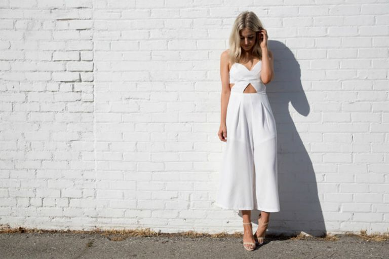 Woman in white jumpsuit for summer