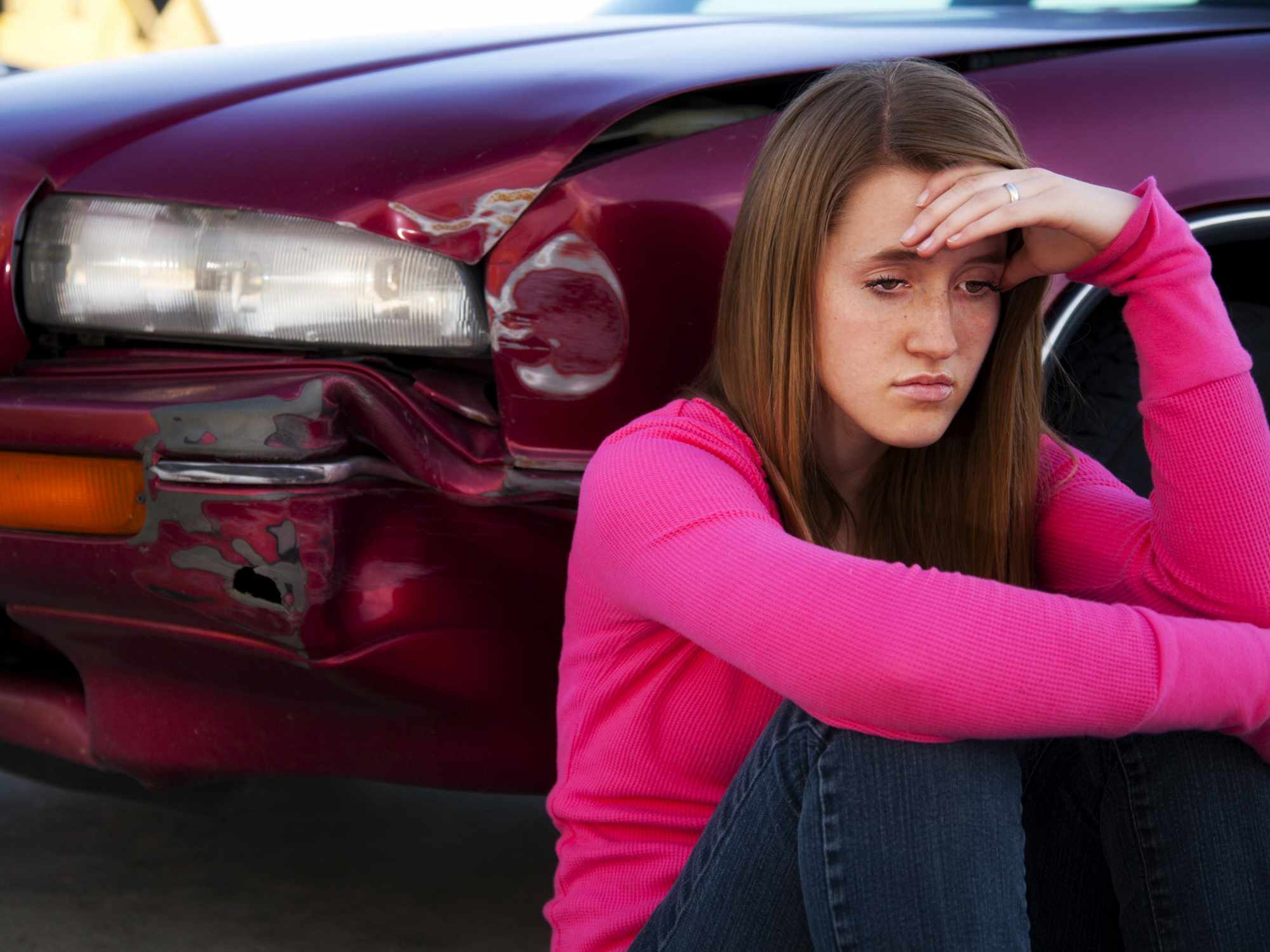 image of young woman lamenting a minor auto collision