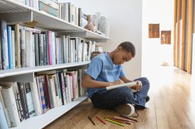 Young boy drawing at home