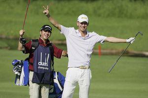 Pro golfer Marcel Siem celebrates making a double eagle