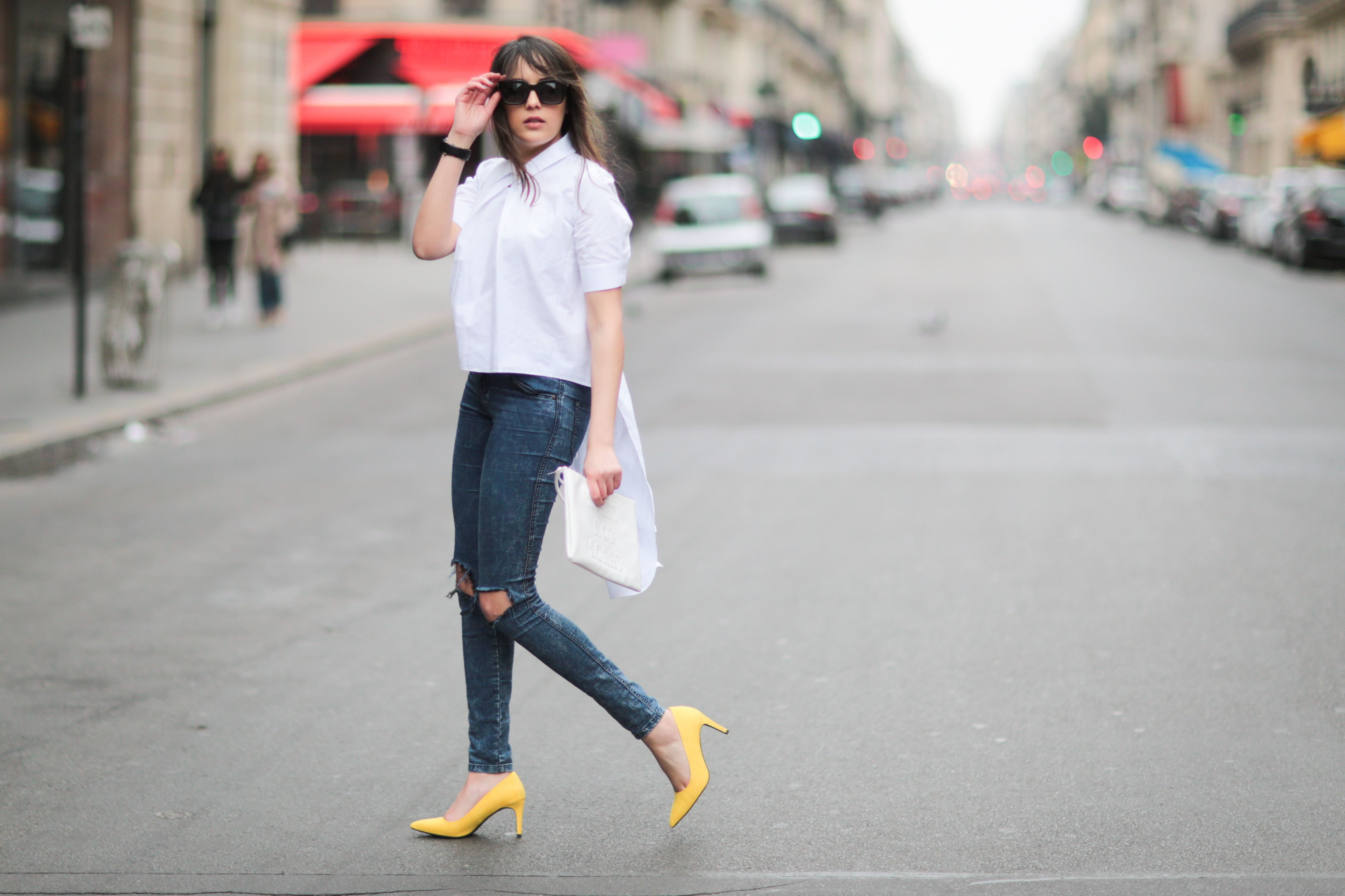 Street style photo of woman in jeans and high heels