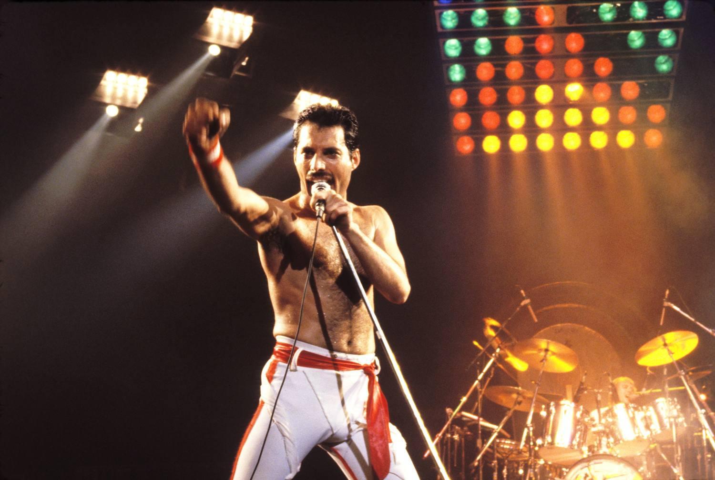 Freddie Mercury performing on stage.
