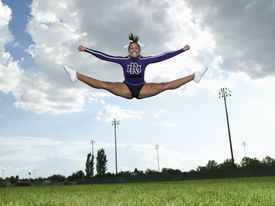Cheerleader doing Toe Touch Jump