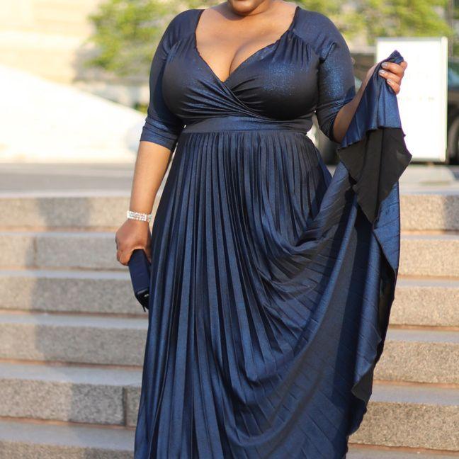 Woman in navy blue ballgown