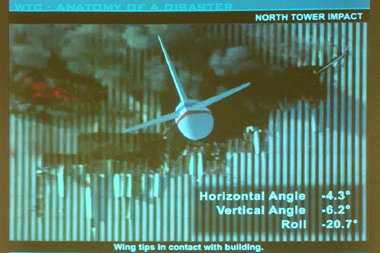 computer presentation slide of wing tips in  with building, horizontal angle -4.3 degrees, vertical angle -6.2 degrees, and roll -20.7 degrees