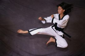 Tae Kwon Do Leap Kick - Woman practices martial arts