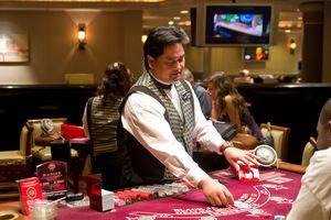 Dealing standing over Las Vegas blackjack table