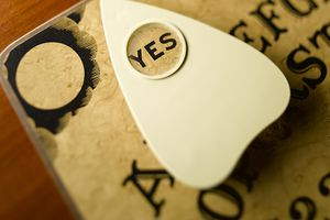 """Ouija board pointing to """"Yes"""""""
