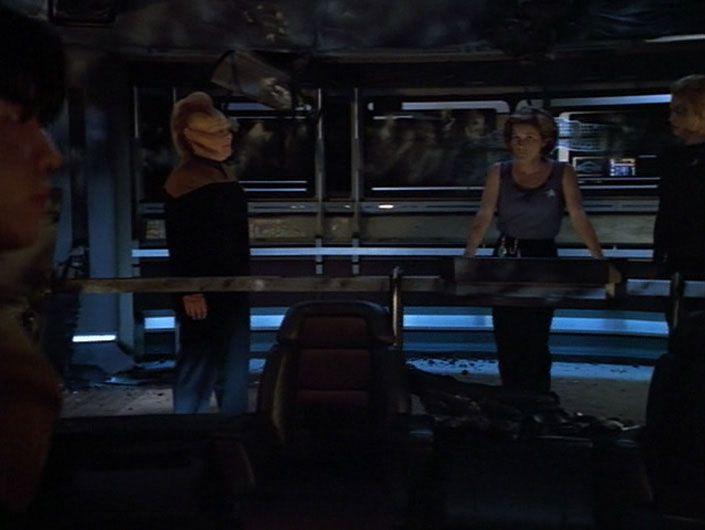 Janeway addresses officers on wrecked bridge