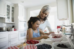 Grandmother and grandchild cooking