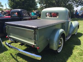 Pickup truck with bed cover in the sunshine