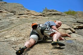 Dr. Bill Springer climbs on Pine Cone Dome at Elevenmile Canyon.