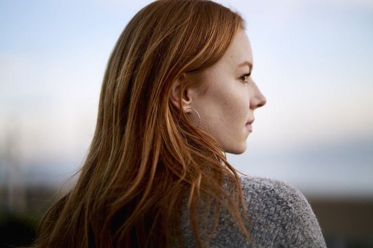 Side profile of woman with long red hair