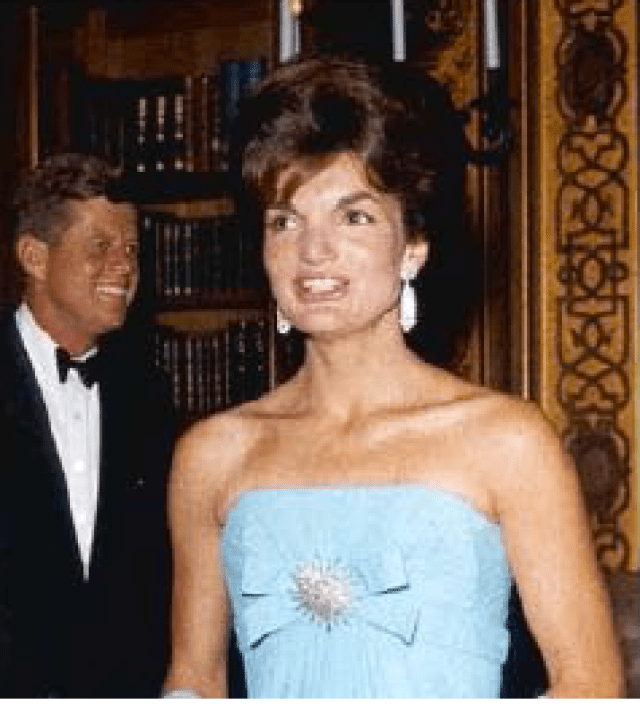 Jackie Wears A Blue Gown With Jewelry