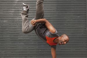 Breakdancing on city sidewalk