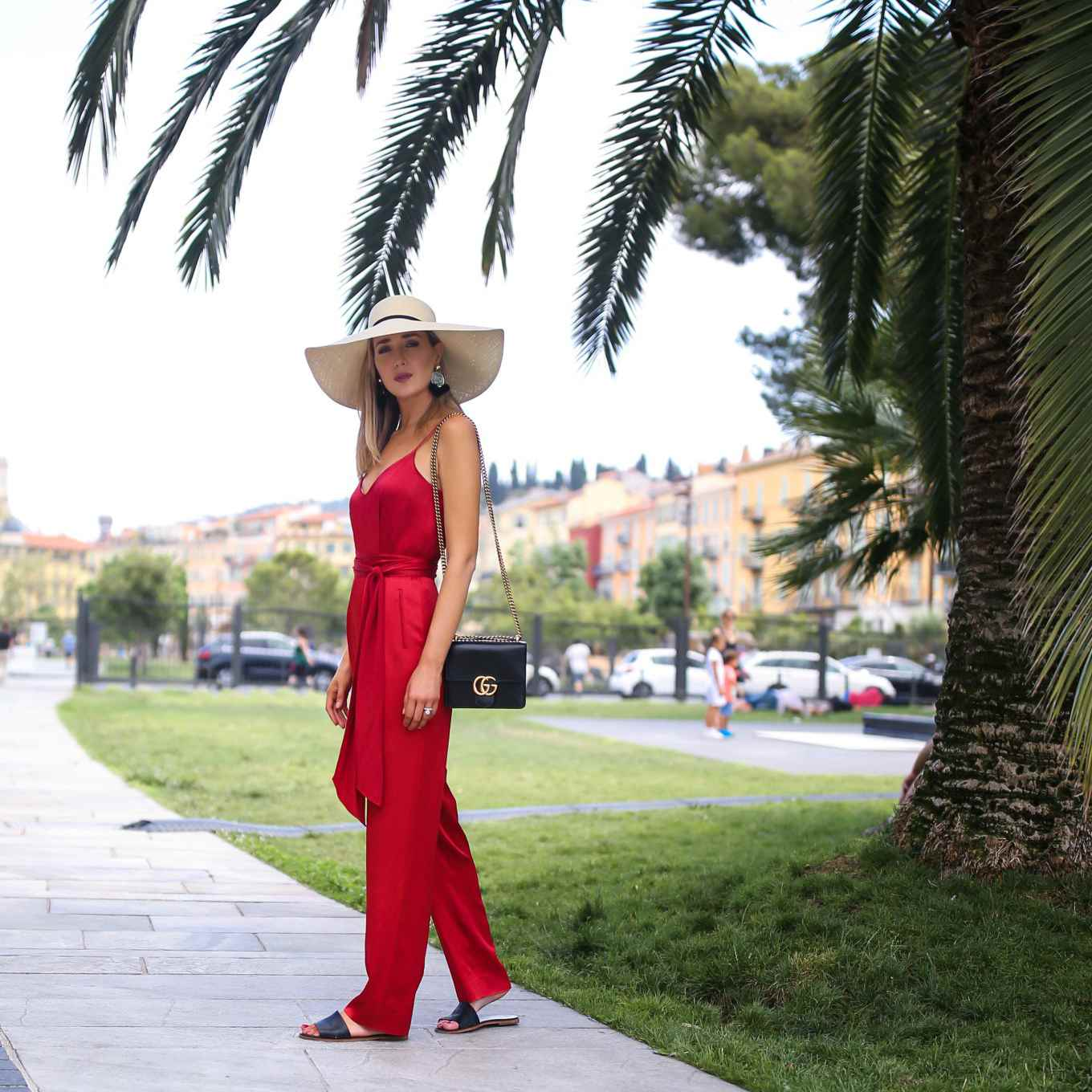 Woman in red jumpsuit for beach vacation