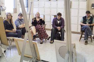 Artists critiquing work in studio