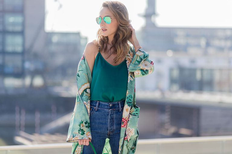 Woman wearing jeans and a floral jacket