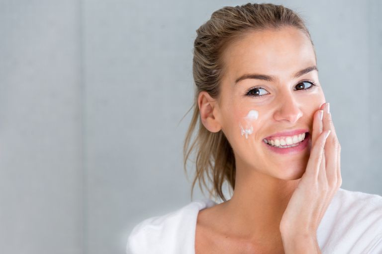 Woman using moisturising cream