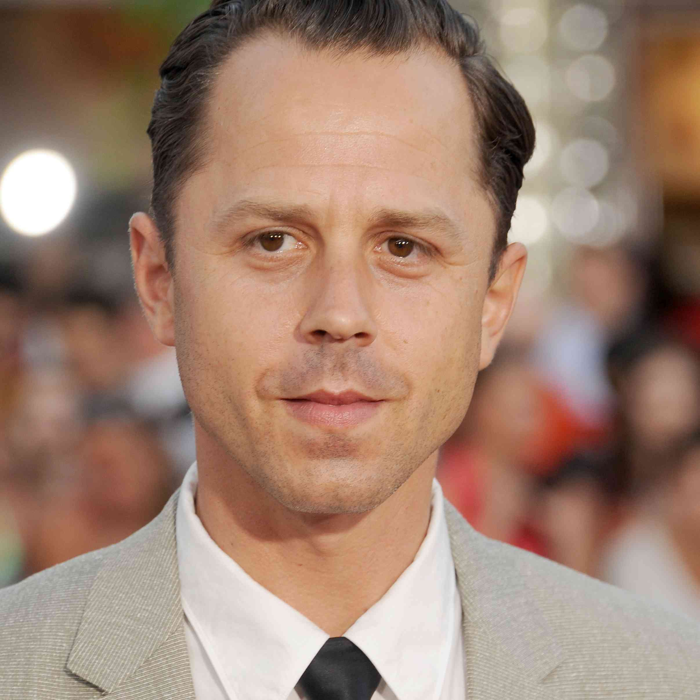 Portrait of Giovanni Ribisi in suit against blurry background.