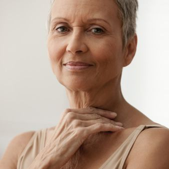 Woman with short gray haircut