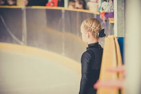 figure skater with hair pulled up and back