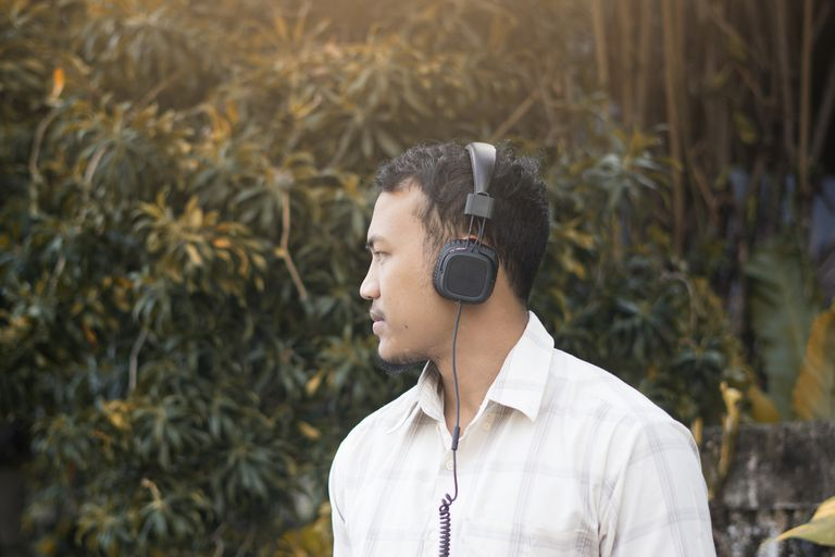 man looking away with headphones