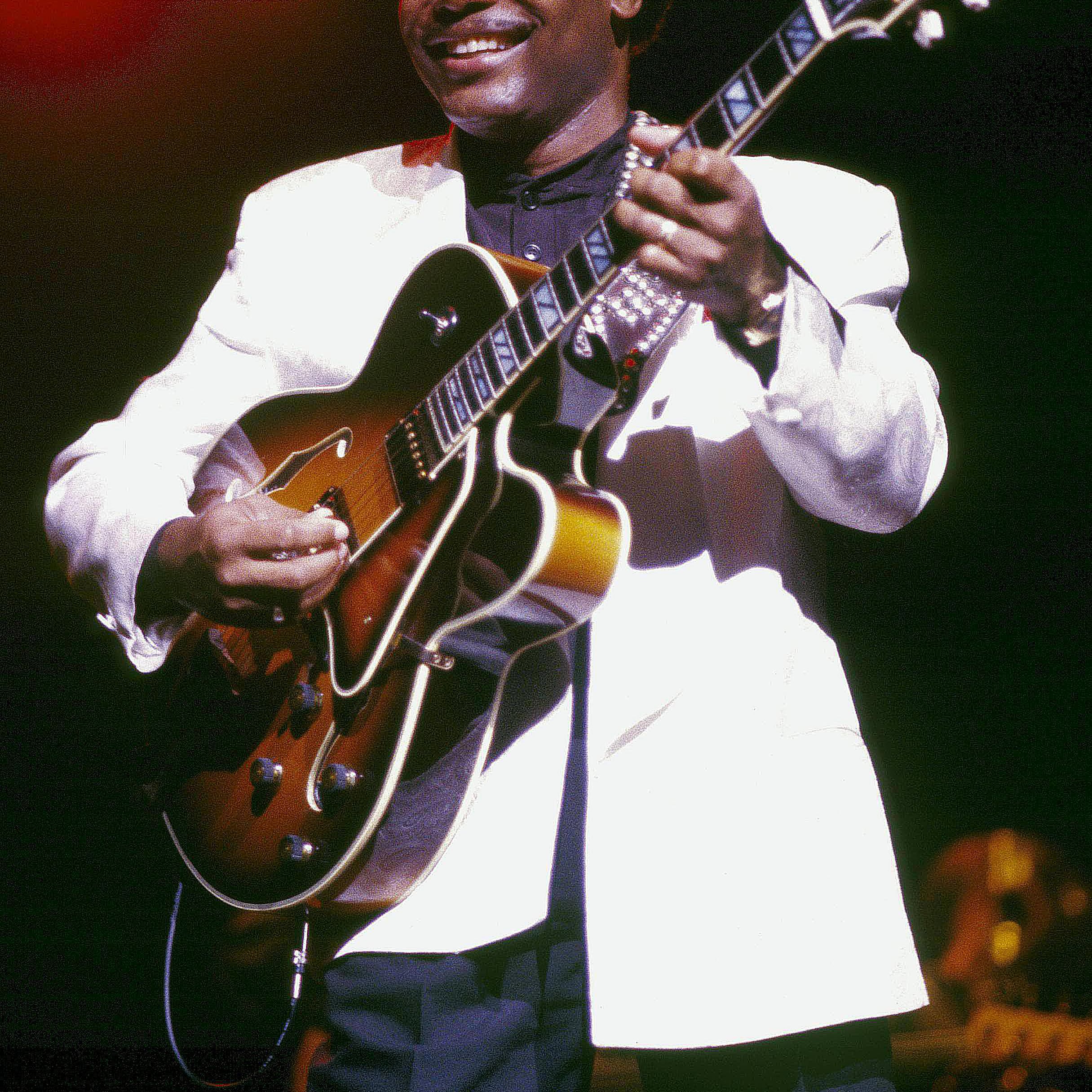 George Benson playing a guitar
