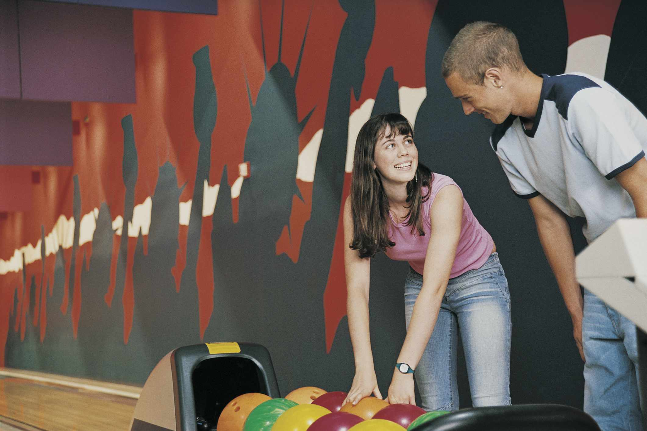 Teenage Couple in a Bowling Alley Playing Tenpin Bowling