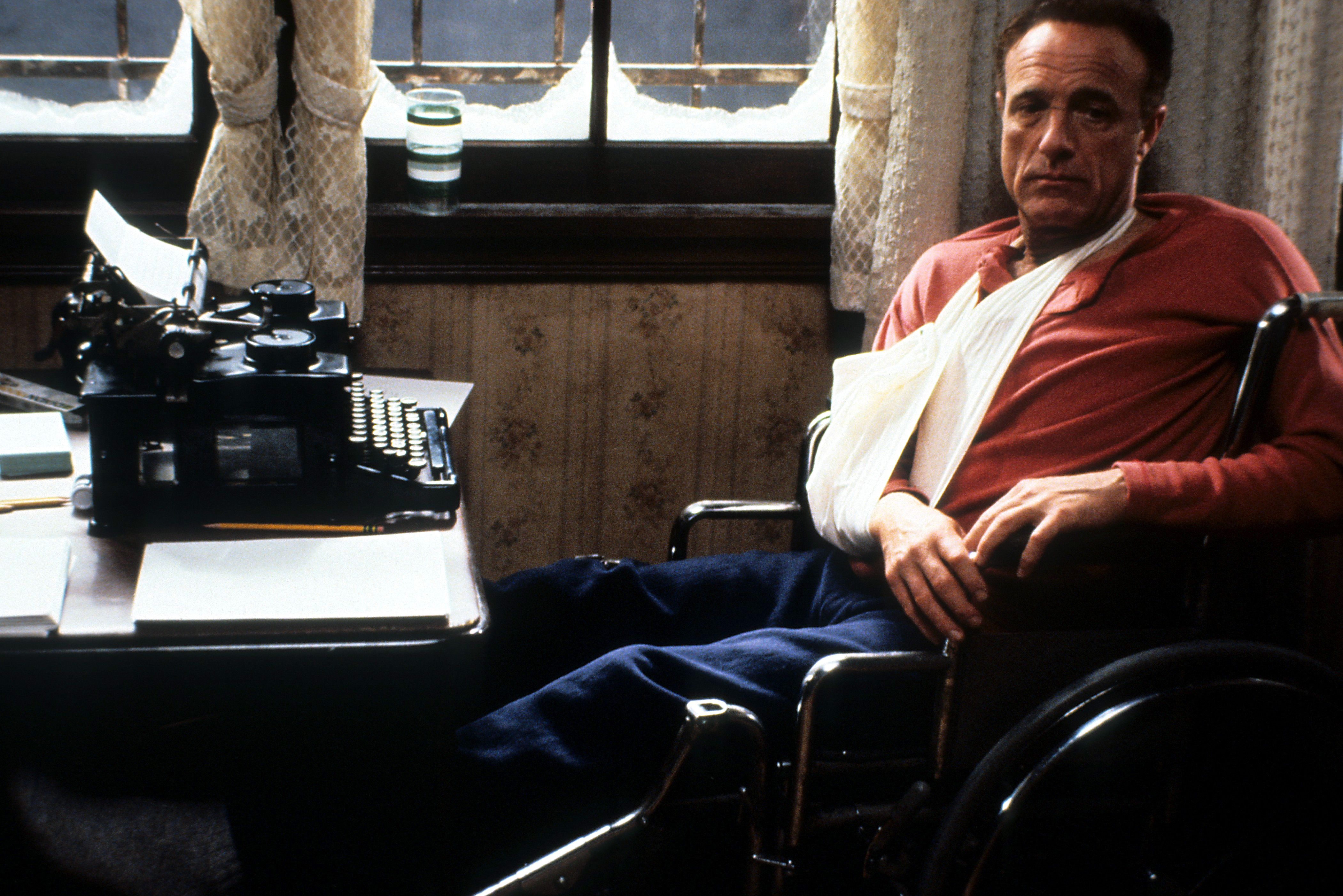 James Caan in a wheelchair in a scene from the film 'Misery' (1990)