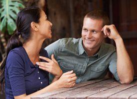 Man looking at woman.